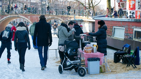 Amsterdam frozen canals, business as usual