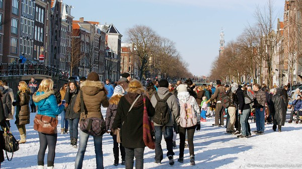 Amsterdam frozen canals, tourists