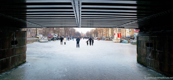 Amsterdam frozen canals bridge