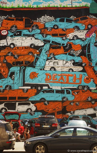 Mural of death, pile of cars Prague