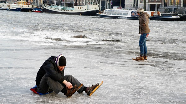 Amsterdam frozen canals, old style skates