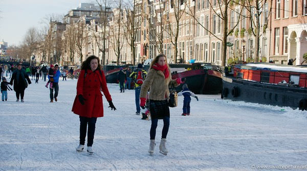 Amsterdam frozen canals, ice skaters