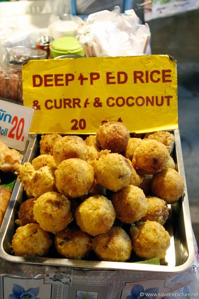 Deepfried rice balls, curry and coconut
