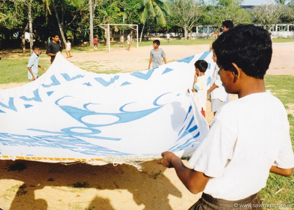 Sri Lanka catamaran art, folding the painted sails